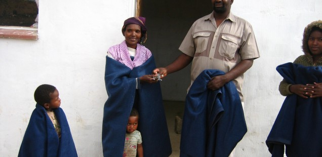 Fr Khoza hands over the keys to a new house owner in Wembezi, Archdiocese of Durban