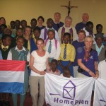 Bishop Graham Rose, Fr Sunday, Fr Ikemerike, beneficiaries of the new houses  with the Homeplan visitors