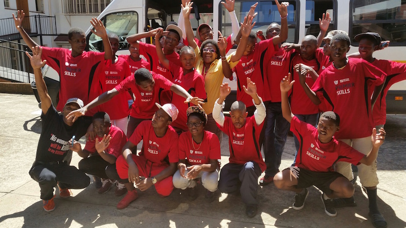 Nandi SZithole of the SACBC AIDS Office and Sithandizingane youth leaving for Pretoria University from the SACBC's Khanya House.