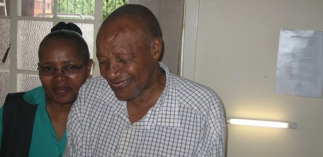 Mr Mangaliso Bavenda, 83 years old, with Nokuthula Sibiya – the matron of Frederic Place – in front of his new bedside lamp.