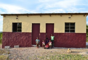 Mrs Makhubela and four of her orphaned grandchildren in front of their new house.